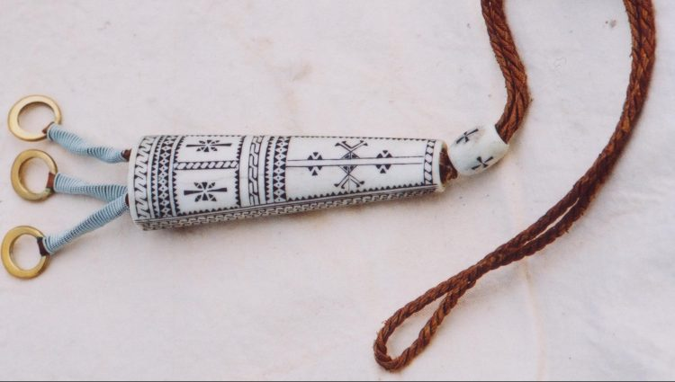 Sami ornament made of bones with nice decorations.