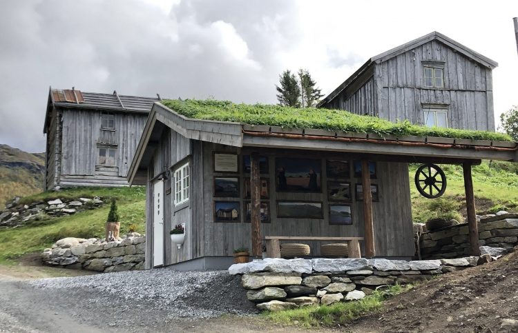 Beautiful Inderdalen Farm with its old, but well-kept silver-grey farmhouses surrounded by green lawn.
